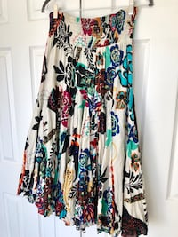 Beautiful flowy skirt from Macys. Wore once. Size L. Super cute with sweater and boots!!  Chantilly, 20152