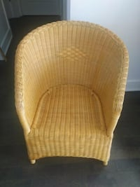 brown wicker armchair with brown wooden base Dorval, H9S 2B8