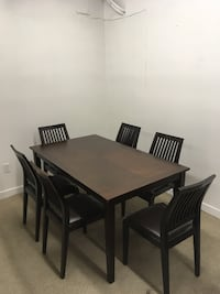 rectangular brown wooden table with six chairs dining set Abbotsford, V2T 2H3