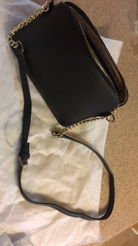 black leather crossbody bag with tassel Gatineau, J8P