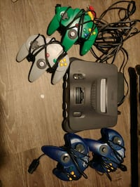 N64 Console, cables, 4 controllers, and 5 games