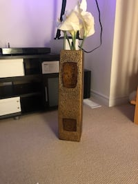 Tall flower vase with flowers