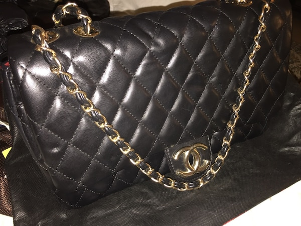 361ed1c02605 Used Quilted black chanel leather crossbody bag for sale in Toronto ...