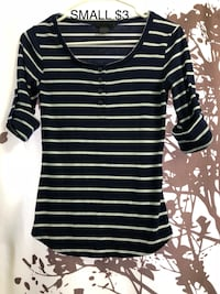 white and black striped elbow-sleeved shirt