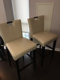 Two brown and beige armless chairs
