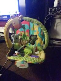 baby's green, yellow and blue Fisher-Price bouncer