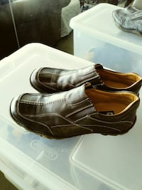 pair of grey leather slip-on shoes