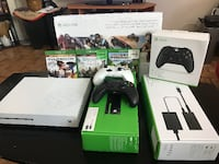 Xbox One console with controller and game cases TORONTO