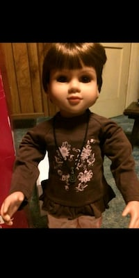 American doll wearing black sweater Erie
