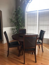 round brown wooden table with four chairs dining set Hazel Green, 35750