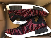 pair of red-and-black Adidas sneakers Toronto, M2J