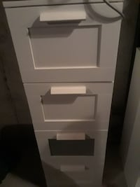 white wooden filing cabinet