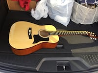 Protocol acoustic guitar- great for learning or beginner-needs a couple of strings replaced