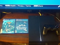 black Sony PS4 console with controller and game ca Temple Terrace, 33617
