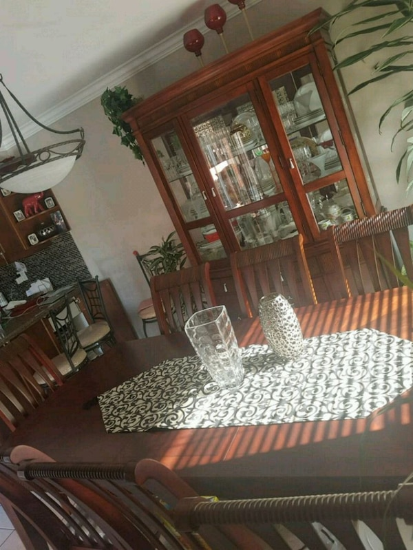 Good condition 8 chair table and hutch