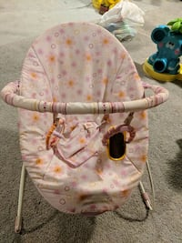 baby's pink and white bouncer