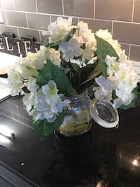 White artificial flowers in mason jar with lid and wAter and rock appearance Mississauga, L5R 0E9