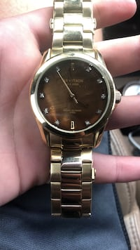 Armitron stainless steel gold watch worn less than 15 times
