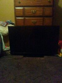 black flat screen TV with brown wooden TV stand Mobile, 36619