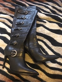 pair of black leather knee-high pointed-toe heeled boots Calgary, T2V