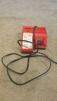 red and black Milwaukee power tool charger