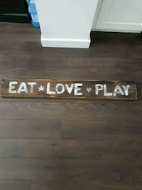 Wooden sign .