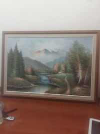 rectangular brown wooden framed painting of green leaf trees near body of water from brown mountain Calgary, T2A 1K8