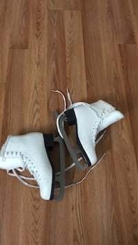 pair of white leather high-top sneakers