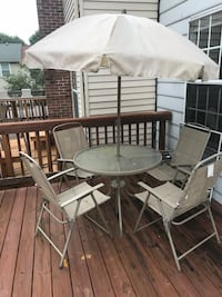 round black metal patio table with four chairs set Gaithersburg, 20878