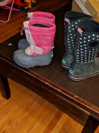 toddler's black-and-pink Columbia duck boots