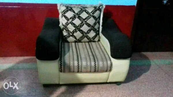 white and black fabric sofa chair