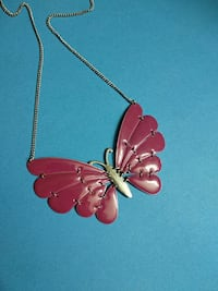 red and gold-colored butterfly pendant necklace