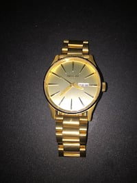 round gold Nixon analog watch with link bracelet Pickering