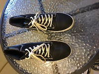 Pair of black-and-white vans sneakers size 9 Winnipeg, R2K 4A1