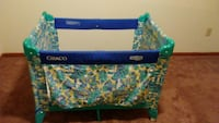 baby's blue and green Graco pack and play