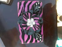 black, pink, and white floral bag Amarillo, 79107