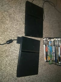 2 ps2s with controller each and hook ups games St. Catharines, L2T 2A7