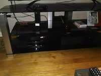 "TV stand in the box, holds a 65"" TV. Retail $198 want $100.  Winnipeg, R3B 2W8"