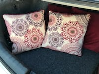 two white-red-and-purple throw pillows