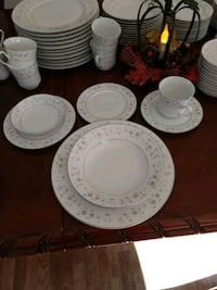 Grey and yellow floral ceramic dinnerware set with silver trim. Vienna, 22180