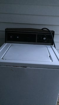 black and white top-load clothes washer