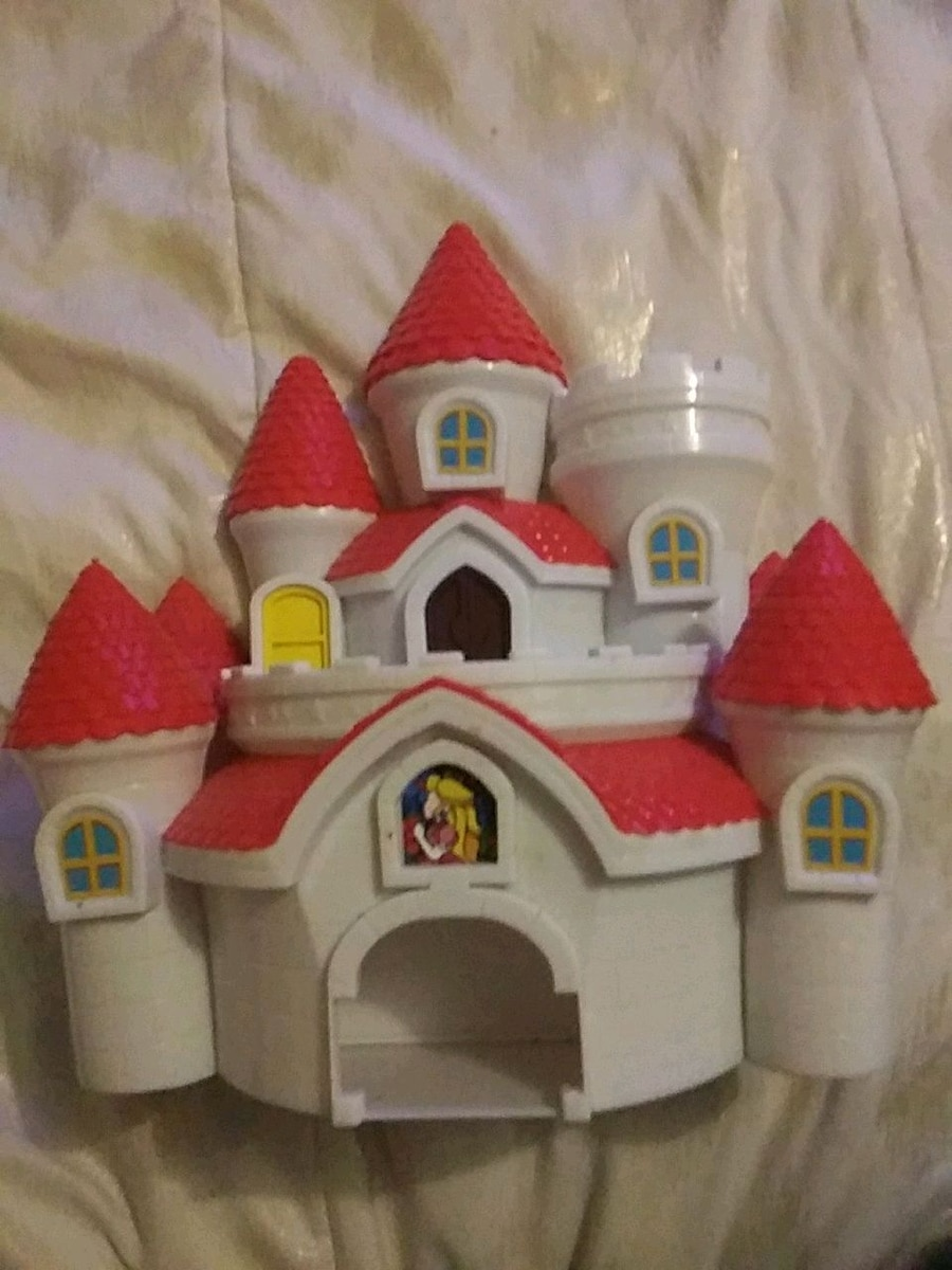 Photo White and red plastic toy house