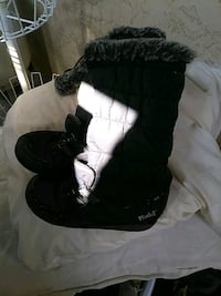 pair of black sheepskin boots 2236 mi