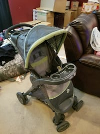 baby's grey and green stroller