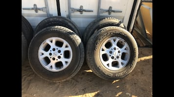 """Set of 16"""" Grand Cherokee wheels and tires."""