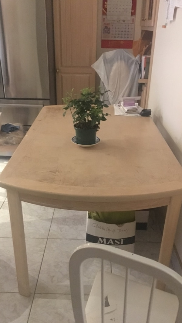 brown wooden table with white ceramic vase