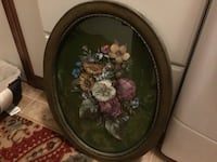 Round brown wooden framed painting of flowers New York, 10468