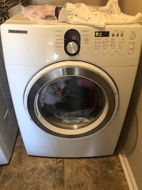 white Samsung front-load clothes washer 26 mi