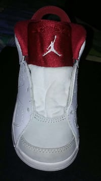 white-and-red Jordan basketball shoes