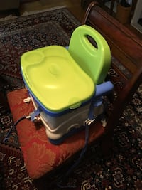 As new Fisher Price strap on high chair with tray and cover